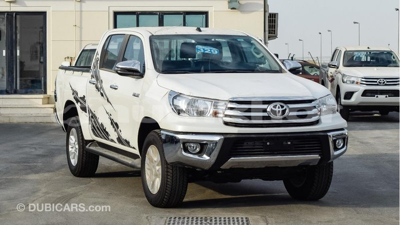 Big with watermark toyota hilux bumthang import dubai 2284