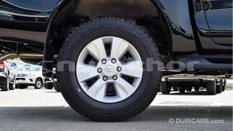 Big with watermark toyota hilux bumthang import dubai 2286