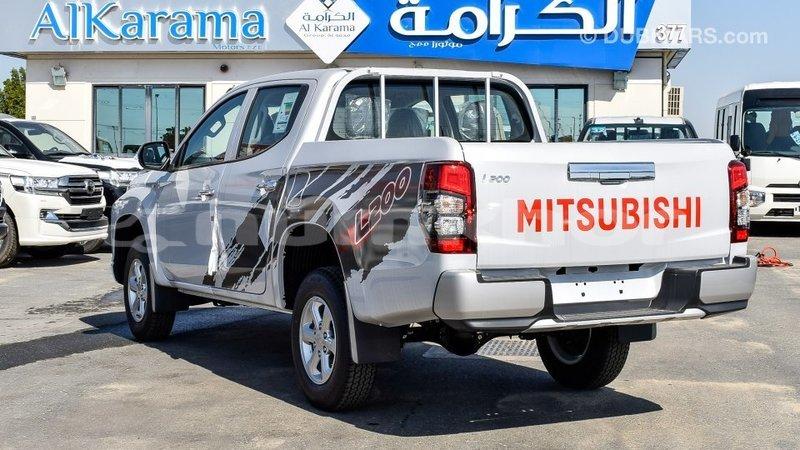 Big with watermark mitsubishi l200 bumthang import dubai 2339