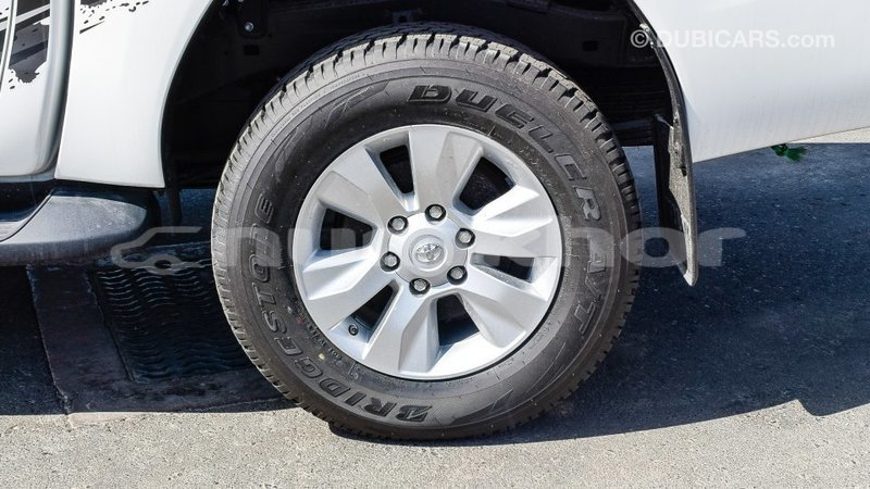 Big with watermark toyota hilux bumthang import dubai 2347