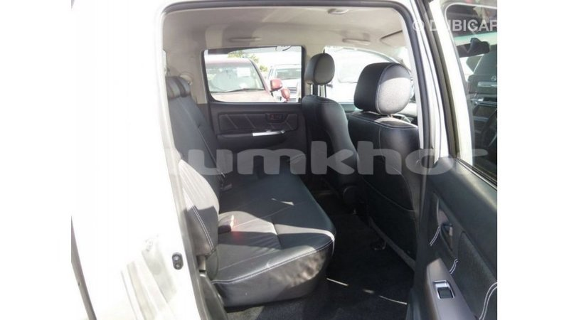 Big with watermark toyota hilux bumthang import dubai 2817
