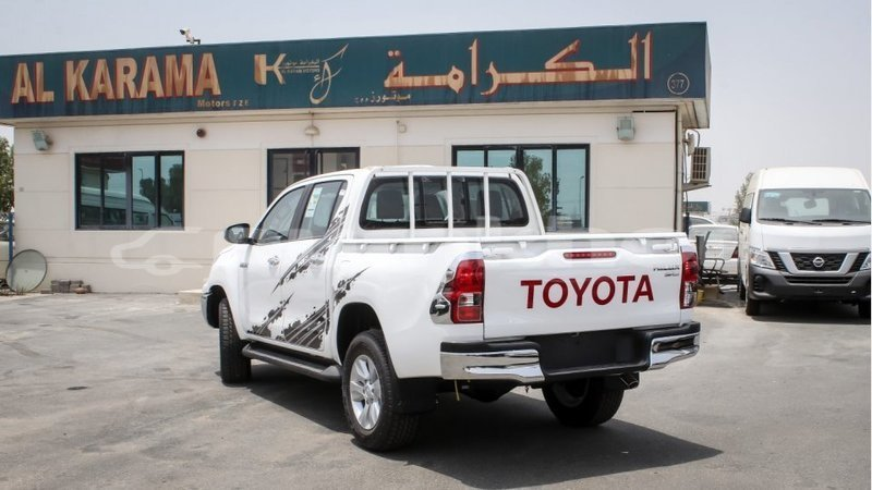 Big with watermark toyota hilux bumthang import dubai 2980