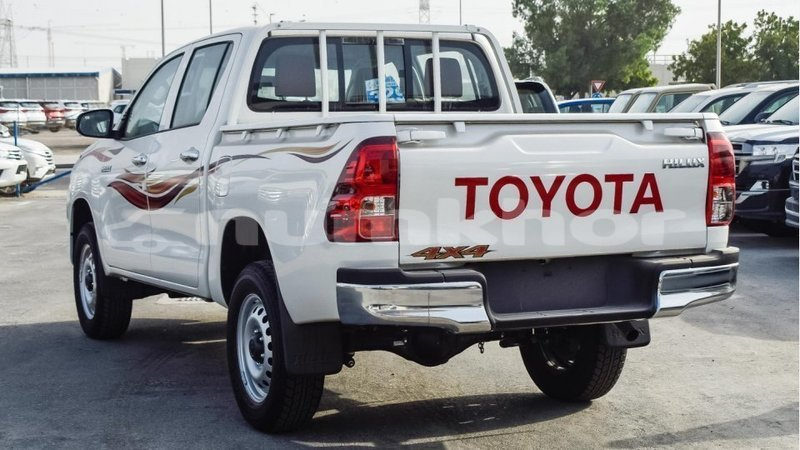 Big with watermark toyota hilux bumthang import dubai 3173