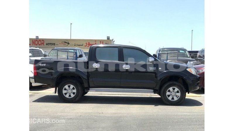 Big with watermark toyota hilux bumthang import dubai 3693