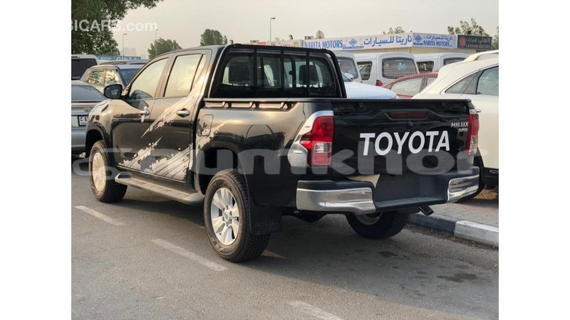 Big with watermark toyota hilux bumthang import dubai 3899
